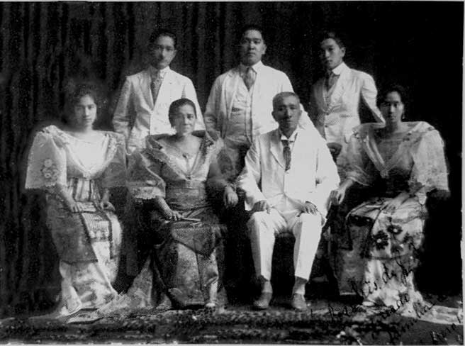 A formal picture with Jose standing in the middle together with Felisa, Paciencia, Pedro and Francisco.
