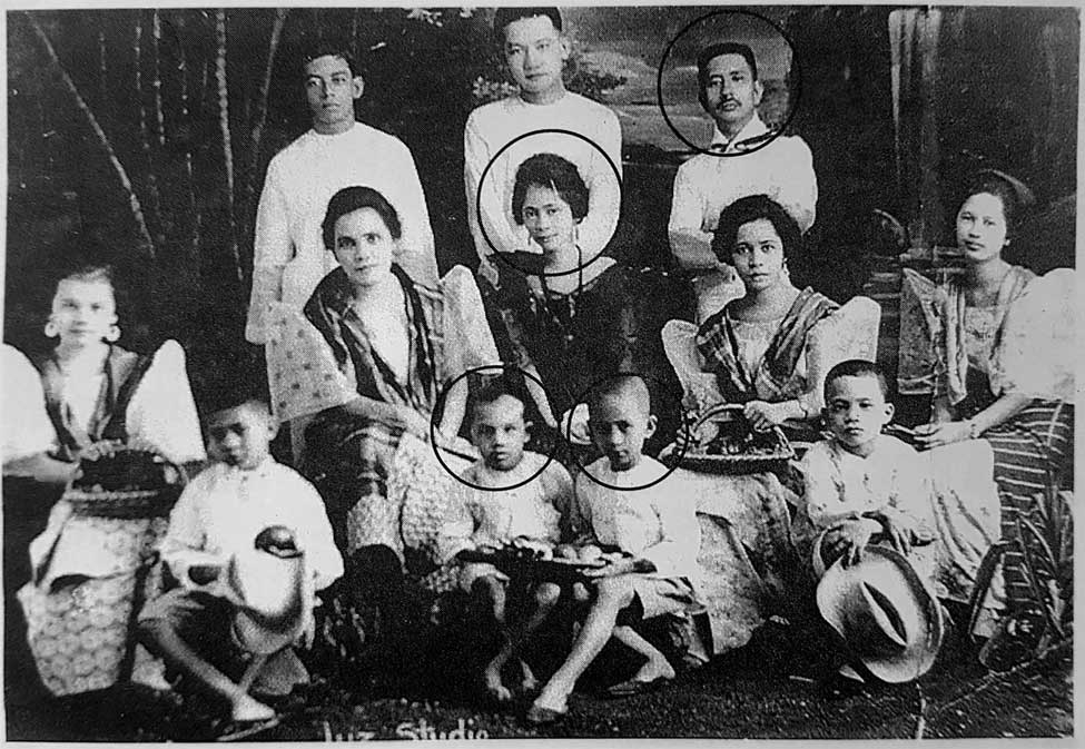 German and wife Paz Del Prado posing in their saya at baro and camisa chino with Nahum(Left w/ circle) and Joaquin(right w/ circle) and relatives & friends.